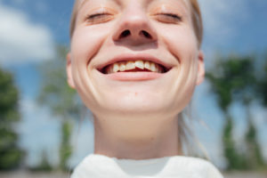 smiling girl with crooked teeth